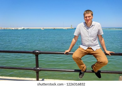 Bari, Italy - July, 2014: Man on embankment near Adriatic Sea in Italian city Bari. Bari is capital city of Metropolitan City of Bari and of Apulia region. Embankment promenade Imperatore Augusto