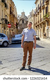 Bari, Italy - July, 2014: Man stands on street in Italian city Bari. Bari is capital city of Metropolitan City of Bari and of Apulia region, on the Adriatic Sea, in southern Italy