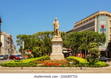 Bari, Italy - July, 2014: Statue of Niccolo Piccinni with the Palazzo Del Governo in the background, Bari, Puglia, South Italy. Bari is capital city of Metropolitan City of Bari and of Apulia region
