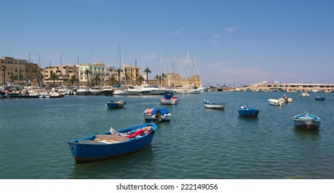 BARI, ITALY, JUNE 16, 2014: Fishermen boats are anchoring inside port of Bari in Italy.