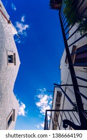 Bari, Italy - March 8, 2019:  Streets with houses with whitewashed walls of the typical Italian city of Locorotondo.