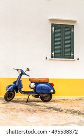 Bari, Italy - September 10, 2016: Scooter Vespa parked on old street in Bari, Italy