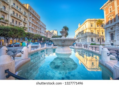 Bari, Puglia, Italy - 23 February, 2019: View to Fountain Fontana Corso Cavour and Theater Teatro Petruzzelli . The capital of Apulia region, a big city on the Adriatic sea