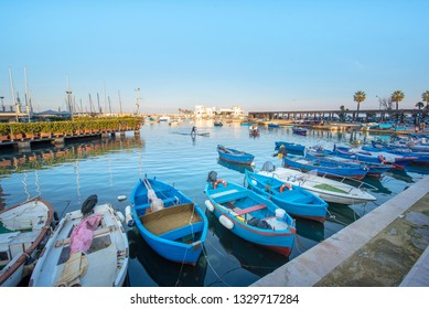 Bari, Puglia, Italy - 23 February, 2019: Sea view of harbor and boats in downtown of Bari, the capital city of the Metropolitan City of Bari and of the Apulia region, on the Adriatic Sea