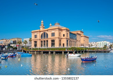 Bari, Puglia, Italy - 25 March, 2019: Sea view of Teatro Margherita theater in downtown of Bari, the capital city of the Metropolitan City of Bari and of the Apulia region, harbor and boats