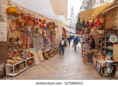 Bari, Puglia / Italy - December 22 2018: View of a narrow street in  Bari, Puglia, Italy, Bari vecchia, traditional open market shops with souvenir for tourists