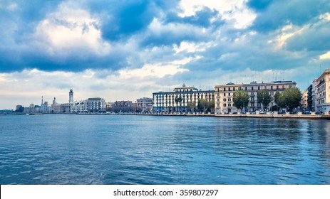 Bari seafront city view from marina. Blue sea and cloudy sky. Filtered image