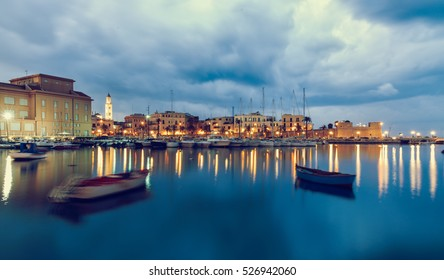 Bari seafront city view from marina. Blue sea and cloudy sky. Long exposure blurred  Filtered image