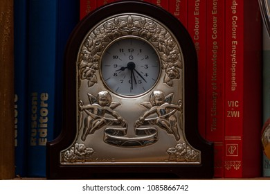 Bari/Italy - 04 21 2018: A metal clock and some signs of aging, to indicate that there is always time for books. A good read is always synonymous with great knowledge.