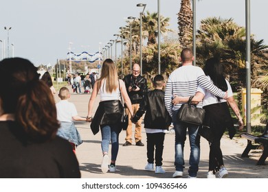 Bari/Italy - 04 21 2018: A photographer performs a service on a family, at work on a sunny spring afternoon.