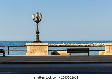 Bari/Italy - 04 21 2018: View of the waterfront of Bari, Italian city. A bench where you can sit and watch the sea.