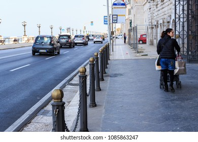 Bari/Italy - 04 21 2018: A walk to the seafront of the city of Bari, on a spring afternoon, between sidewalk and urban traffic.