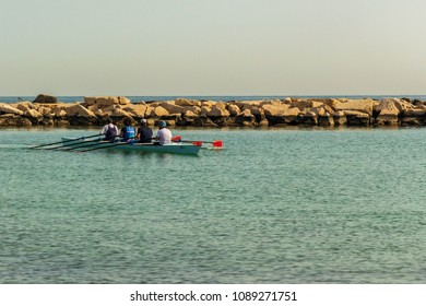 Bari/italy - 05 01 2018: Workouts on a morning of May on the sea of Bari, in southern Italy. Four men on rowing.