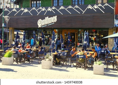 BARILOCHE, ARGENTINA - 16 February 2019. A view from the Calle Mitre which is the main street of Bariloche. Shops and restaurants are putting tables on the street in summer.