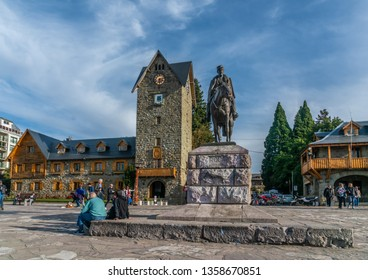 Bariloche, Argentina, 20th March 2019 - Tourist passing the city hall of the touristic town of Bariloche in the famous Patagonia region