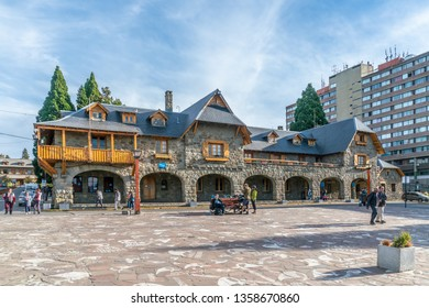 Bariloche, Argentina, 20th March 2019 - Tourist passing the old post office and now tourist inromation of the touristic town of Bariloche in the famous Patagonia region