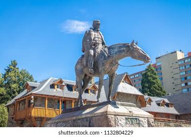 Bariloche, Argentina - Feb 15, 2018: President Roca statue at main square near Civic Center (Centro Civico) in downtown Bariloche at sunset - Bariloche, Patagonia, Argentina