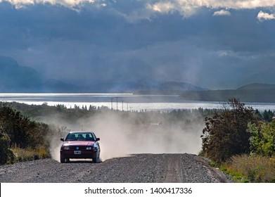 Bariloche, Province Rio Negro/ Argentina - December 15 2008: Car raising dust along an unpaved road near Bariloche