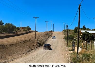 Bariloche, Province Rio Negro/ Argentina - December 14 2008: Cars raising dust along an unpaved road near Bariloche