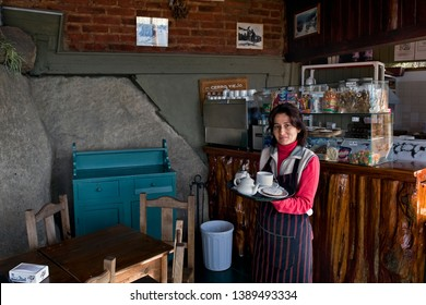Bariloche, Rio Negro/ Argentina - April 17 2014: Joung waitress in the cafeteria on the Cerro Viejo