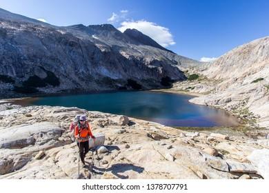 BARILOCHE, RIO NEGRO, ARGENTINA - FEBRUARY 4 2019: a hiker and Creton lagoon near Bariloche in Patagonia Argentina