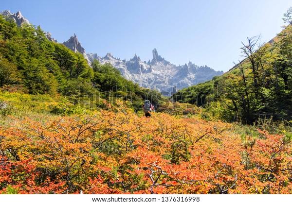 """BARILOCHE, RIO NEGRO, ARGENTINA - MARCH 27 2019: Catedral mountain (""""Cerro Catedral"""") view during the autumn in Bariloche, Patagonia Argentina"""