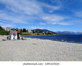Bariloche/Argentina - February 9, 2017: view of a pebble beach on Lake Nahuel Huapi. It is written in the cabin: Association of Lifeguards of Bariloche.