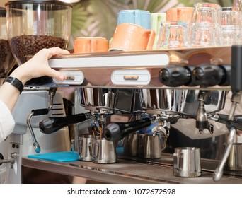 Barista is brewing coffee with professional espresso machine