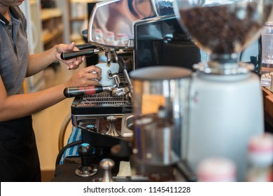 Barista Cafe Making Coffee Preparation Service with coffee machine in coffee shop