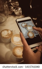 Barista conducts a trainee masterclass, teaches work. Trainee takes pictures