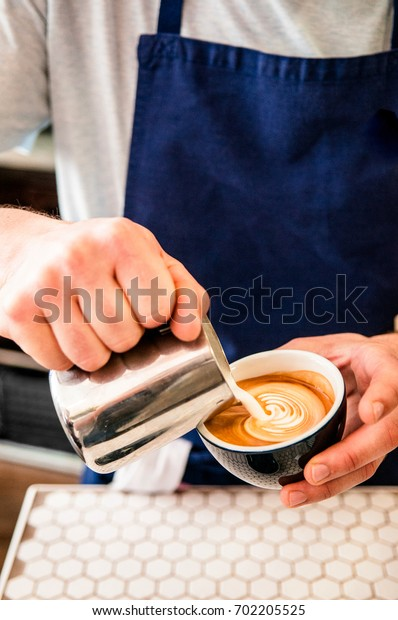 Barista created latte art coffee.
