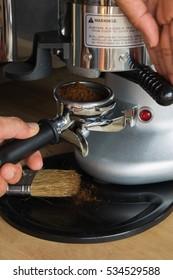 Barista filling coffee pours into port filter prepare make brew coffee