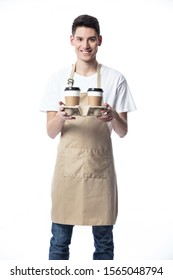 Barista holding a take out tray of disposable coffee cups. isolated on white.