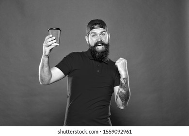 Barista job position. Coffee shop staff wanted. Barista prepared drink for you. Cheerful barista. Man bearded hipster red cap uniform hold paper coffee cup. Barista recommend caffeine beverage.