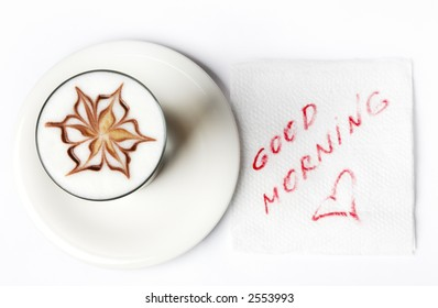 barista latte coffee glass with good morning note on tissue