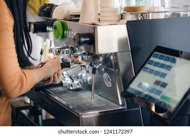 Barista make coffee latte art with espresso machine in cafe vintage Color tone ,Barista Cafe Making Coffee Preparation Service Concept ,Close-up of espresso pouring from coffee machine.