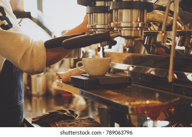 Barista make coffee latte art in coffee shop cafe