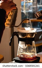 barista making alternative way of brewing coffee in the coffee shop