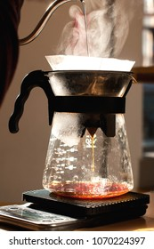 barista making alternative way of brewing coffee in the coffee shop hario v60 soft light