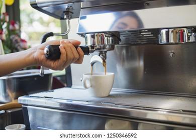 Barista is making black coffee americano.