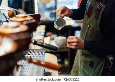 Barista making cappuccino, bartender preparing coffee drink