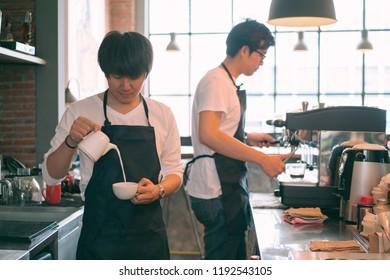 Barista making coffee for his customer