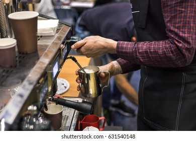 Barista making coffee with coffee machine, hands close up, professional service