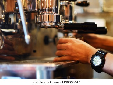 Barista are making coffee on coffee machine in blurred coffee shop background