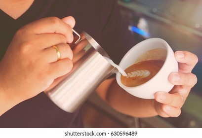 The Barista making a cup of coffee latte in coffee shop.
