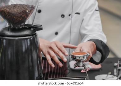 Barista making a cup of coffee.Batista preparing fresh brewed coffee.