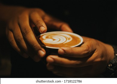 Barista making a cup of latte