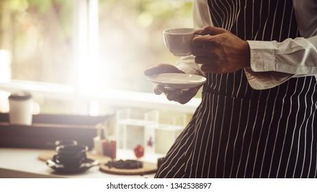 Barista making Espresso,  Americano, Cappuccino, Latte, Mocha, and preparing coffee drink.