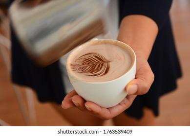Barista making latte art coffee practice