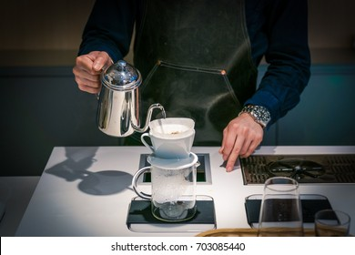 Barista poring a filtered coffee
